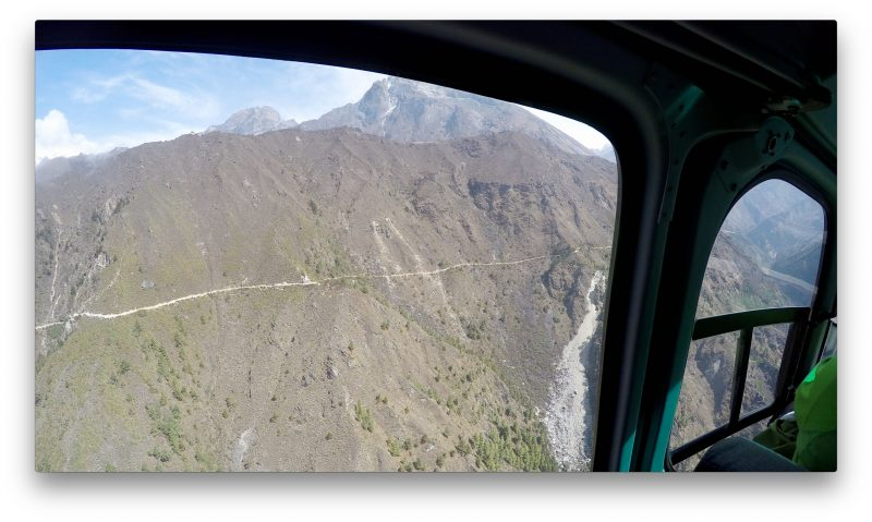 The Tenzing-Hillary memorial stupa, visible as a small white dot on the trail to Tengboche. (GoPro Screenshot)