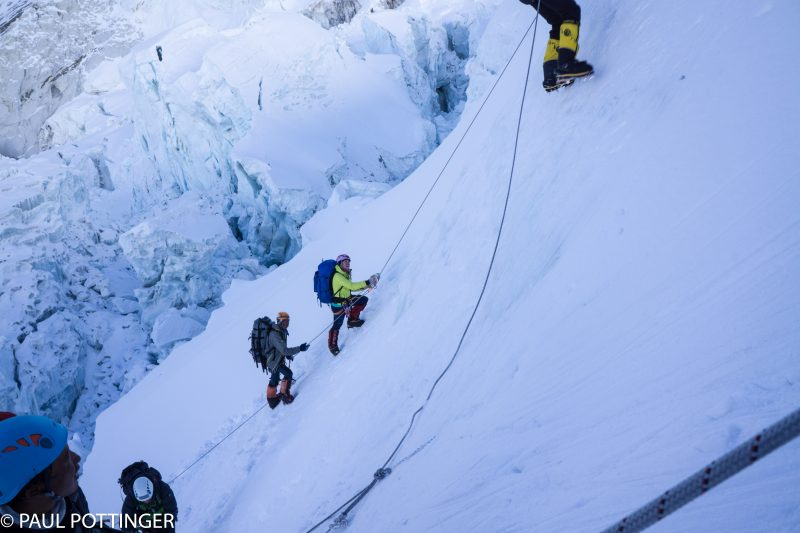 Kim and Mingma climb out of the Sea of Destruction to the low-angle headwall base, and approach the vertical portion above.