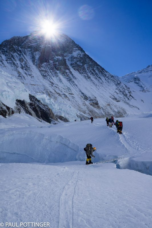 The sun rises above the summit of Everest just as I approach the first horizontal ladder of the day... as always, Pasang Kami prepares the way for me.
