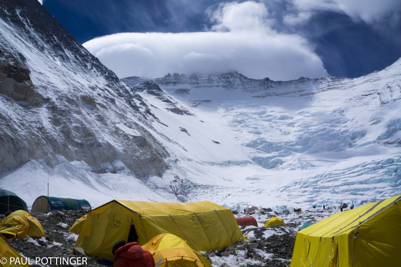 Summit of Lhotse, with countless climbers ascending the Face in brutal winds.