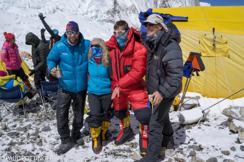 IMG Guides Mike Hamill, Emily Johnston, and Jonathan Schrock pose with Classic Climber Bart Williams at Camp 2.