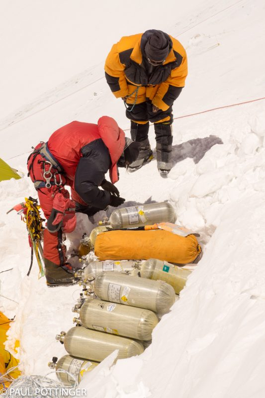 Sherpa guides working on the oxygen stockpile. Nicky and Bob's sharps staked out nearby.