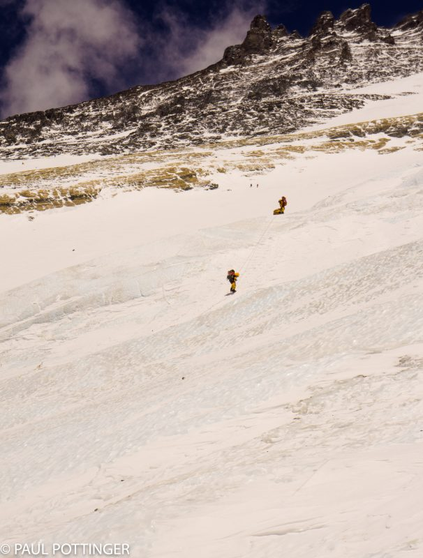 A climber descending from the summit rappels the ice face immediately above Camp 3. A good option if you are exhausted or not confident of your grip strength or ability to step carefully.