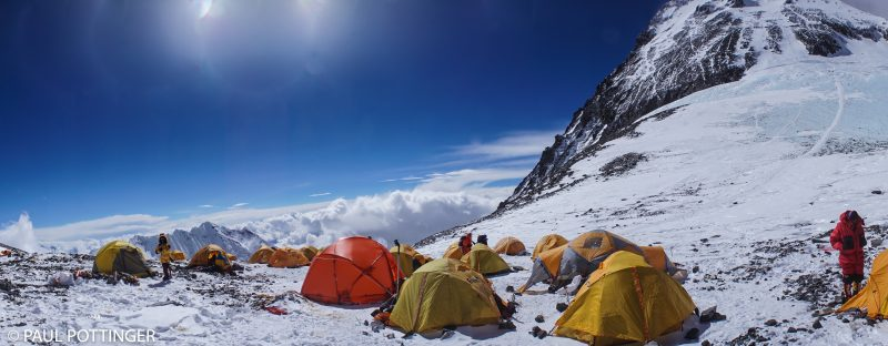 Panorama of Camp 4, Everest above. Josh McDowell sports a red suit on the right side of the picture.