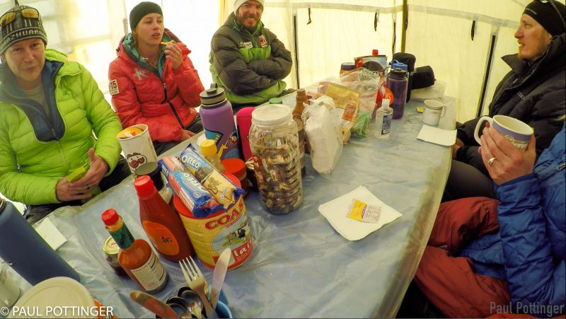 In the dining tent at Camp 2. Discovery of a new can of pizza-flavored Pringles causes quite a stir.... (GoPro Screenshot)