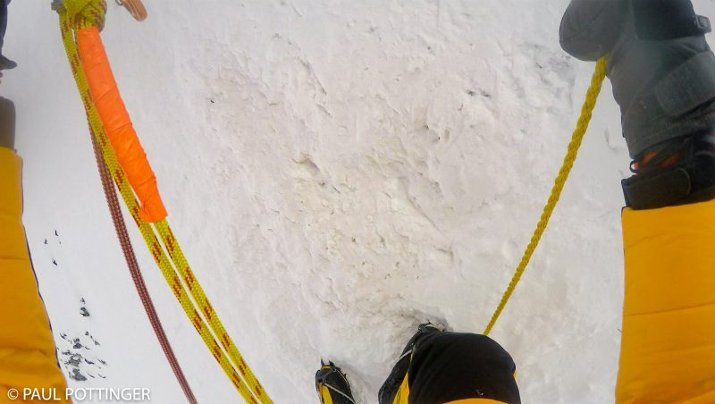 A nice surprise at the base of the Yellow Band cliff: A second line of static woven rope appears. Serves well as a backup handline. Posh to be sure.... (GoPro Screenshot)