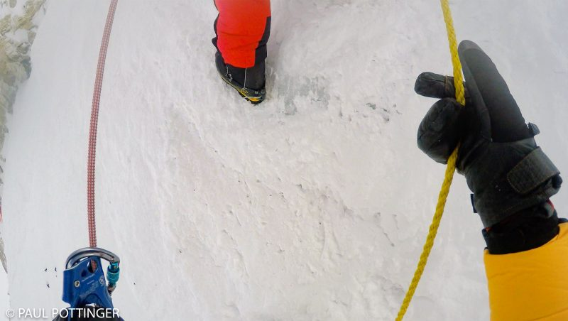 See that solid ice under the thin skin of snow, beneath Pasang Kami's crampons? Makes for a spicy ascent. (GoPro Screenshot)