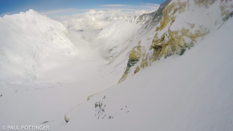 Looking back at the route from the bottom of the first Yellow Band cliff... column of climbers reaches back to Camp 3. (GoPro Screenshot)
