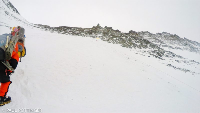 The tiny yellow spot at center are the four tents that comprise Lhotse high camp. Although you cannot see it from here, it sits at the bottom of a straight-shot couloir that goes right to the summit block (seen top right). (GoPro Screenshot)