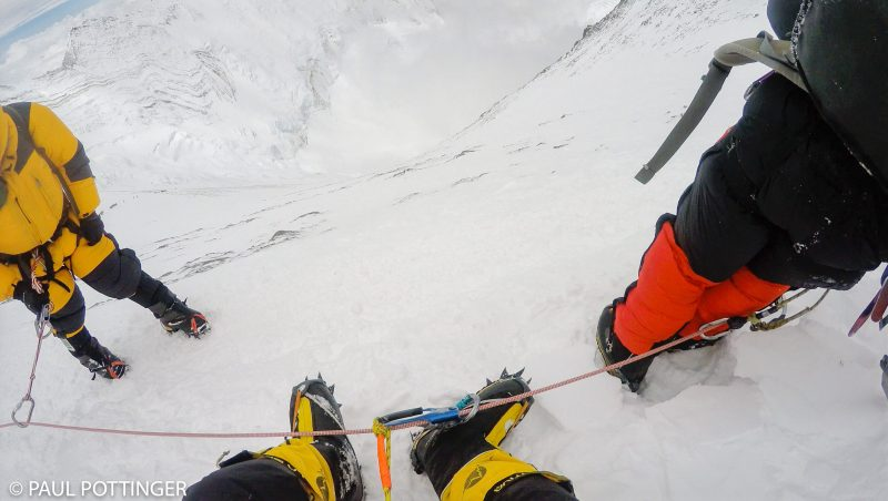 The view from my seat at the break below the Spur, circa 25,500 feet high. Underfoot, beyond the narrow path, the Lhotse face stretches 4,400 feet down to the Cwm. (GoPro Screenshot)