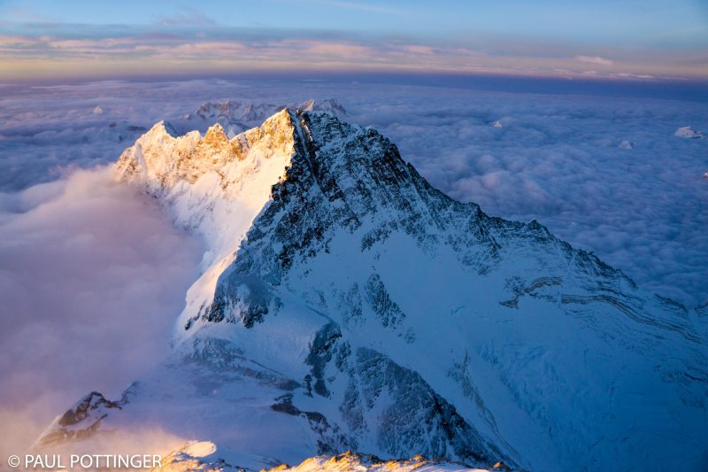 Lhotse at sunrise. Couloir to the summit is clear in this image, the long snowfilled line surrounded by dark rock.