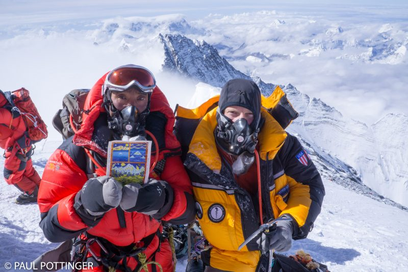 Pasang Kami and me on top. He is holding a card given to us by Lama Geshi. Proud to display it on the summit. Proud to have climbed with this amazing mountaineer.