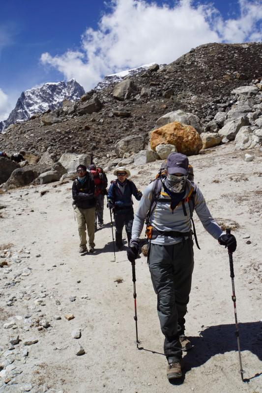 Roger approaching Gorak Shep, Lobuche Peak behind him.