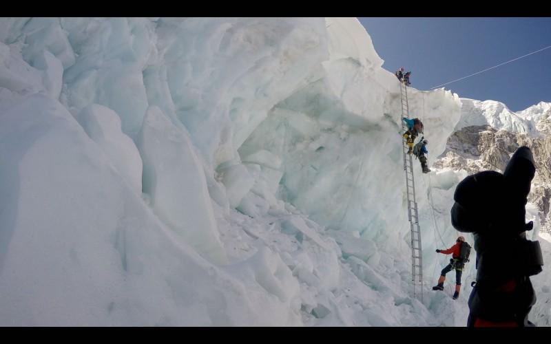 I give a thumbs-up to Ang Pemba, while Emily Johnston makes her way up. (GoPro screenshot)