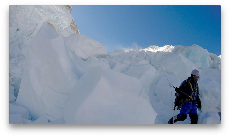 Ang Pemba descending the popcorn below the Sea of Destruction. Sunshine nipping at our heels... (GoPro Screenshot)