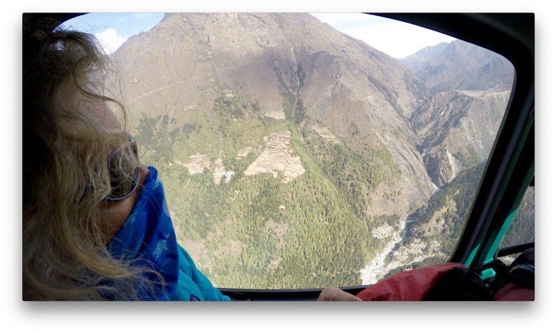 Emily surveys the terrain, including the rugged Phortse trail slashing across the mountainside across the valley. (GoPro Screenshot)