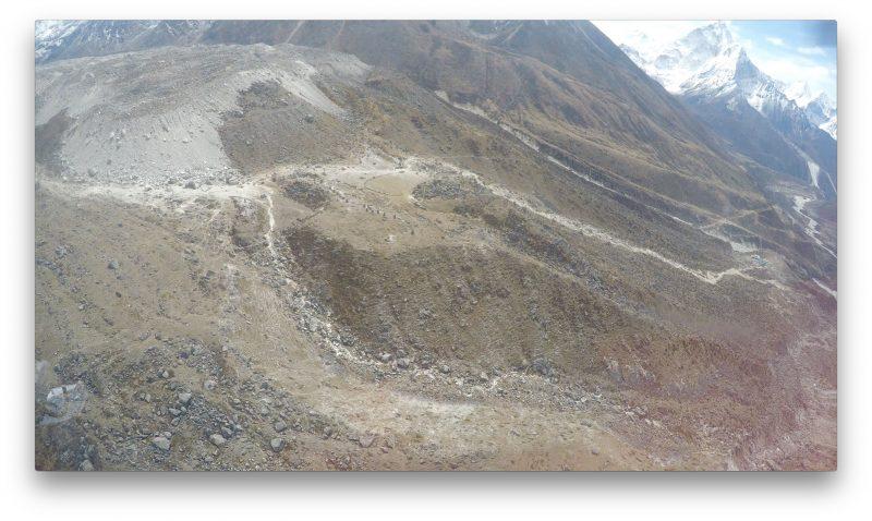 The chortens at Dukla, barely visible as a line of stone pillars, each a memorial to a fallen climber. (GoPro Screenshot)